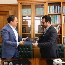 Ahmad Araqchi (R) meets Alexey Tyupanov