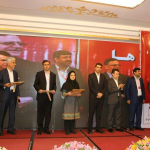 Valiollah Seif (1st R) at a ceremony to unveil the NFC system at Parsian Bank in Tehran on May 13.