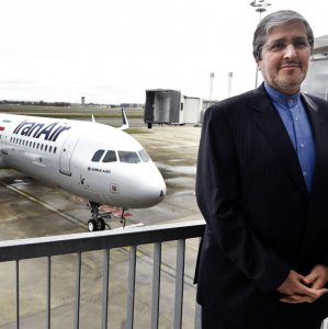 Iran Air CEO Farhad Parvaresh poses with the first Airbus A321 recently delivered to Iran.