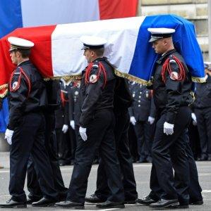 Macron, Le Pen Attend Ceremony for Slain Policeman