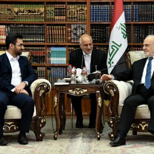 Iran's Telecoms Minister Mohammad Javad Azari Jahromi (L) and Iraqi Foreign Minister Ibrahim al-Jaafari (R) meet in Baghdad, Iraq, on Oct. 18.