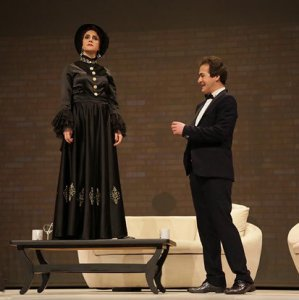 Masoumeh Rahmani (L) and Behnam Sharafi in an earlier performance of the play.