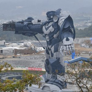 A giant model of a 53-meter-tall Transformer, constructed out of 750 tons of steel, is on display at the construction site of the  virtual-reality theme park in Guiyang city.
