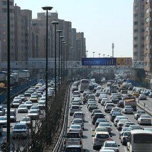 One of Tehran's clogged streets. Mohsen Hashemi Rafsanjani (inset).
