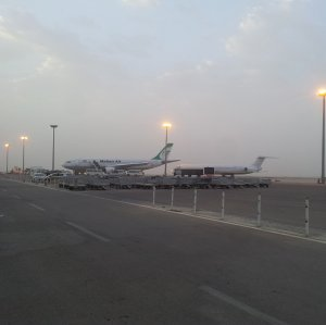 Passengers get off a Mahan Air plane at Al Najaf International Airport in this undated file photo. (Photo: Ejaz Husain)
