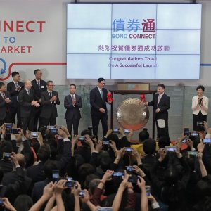 From right, Hong Kong's new Chief Executive Carrie Lam claps hands as PBoC Deputy Governor Pan Gongsheng and Hong Kong Monetary Authority Chief Executive Norman Chan beat a gong to launch the Bond Connect in Hong Kong, July 3.