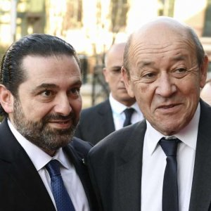 Saad Hariri (L) and French FM Jean-Yves Le Drian at the Cedar Conference in Paris on Friday.