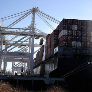 Import of goods jumped to a record high of $204 billion in November.