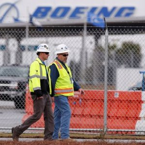 Boeing aims to cut its commercial airplane unit's workforce by 8%.