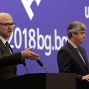 Pierre Moscovici (L) talks to reporters at the National Palace of Culture in Sofia,  as Mario Centeno looks on.