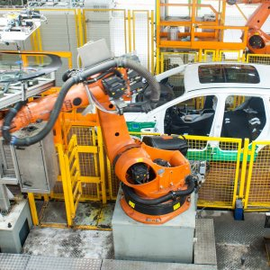 Robots work on a production line at a car factory in Cangzhou city, north China's Hebei Province.