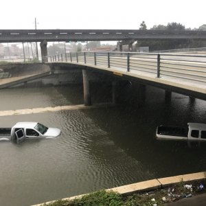 Vehicles half submerged in flood waters under a bridge in the aftermath of hurricane Harvey, in Houston, Texas, August 27.