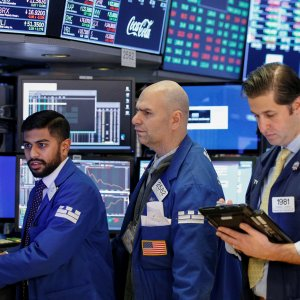 Dow futures dropped more than 100 points in early trading, as traders returned from the long holiday  weekend to face fresh selling pressure for US stocks.