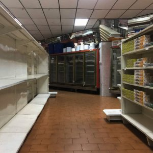 Empty supermarket shelves in Caracas. The government has forced more that 200 establishments  to lower prices in the middle of a hyperinflationary spiral.