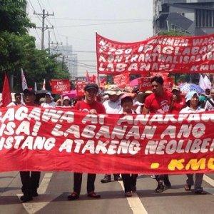 Members of Kilusang Mayo Uno march on Labor Day, May 1.