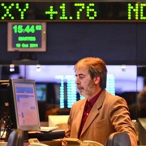 A trader works on the floor of the Buenos Aires Stock Exchange in Buenos Aires.