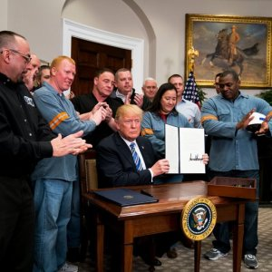 US President Donald Trump signed an order imposing stiff and sweeping new tariffs at the White House on March 8.