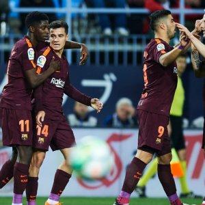 Barca squad celebrate their win.