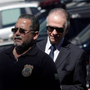 Brazilian Olympic Committee (COB) President Carlos Arthur Nuzman (2nd L) arrives to Federal Police headquarters in Rio de Janeiro, October 5.
