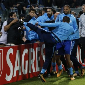 Evra kicks a fan who insulted him  before the match.