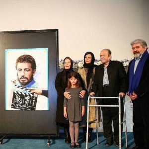 From left: Zahra Khoshkam, Mani Mosaffa, Ehteram Boroumand, Asal Mosaffa, Leila Hatami, Mohammad Ali Keshavarz and Omid Rouhani with the official poster of the festival depicting Ali Hatami
