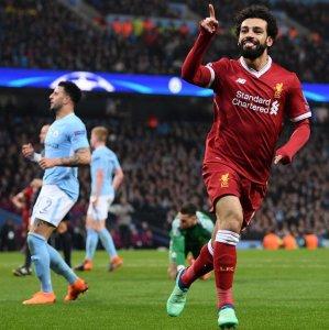 Liverpool's Mohamed Salah rejoices scoring against Manchester City.