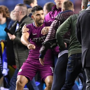 Sergio Aguero clashes with Wigan fans after their invasion  of the pitch.