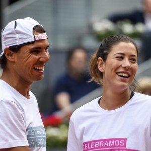 Rafael Nadal (L) and Garbine Muguruza