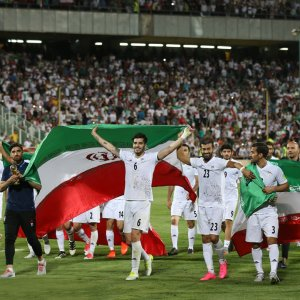 Iranian players celebrate after winning the 2018 World Cup qualifying football match against Uzbekistan at Azadi Stadium in Tehran on June 12.