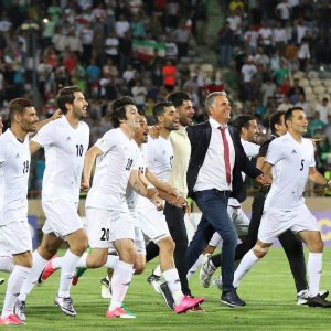 Team Melli members celebrate qualification for the 2018 FIFA World Cup after beating Uzbekistan 2-0 in the third round of World Cup Qualifiers at Tehran's Azadi Stadium on June 12, 2017.