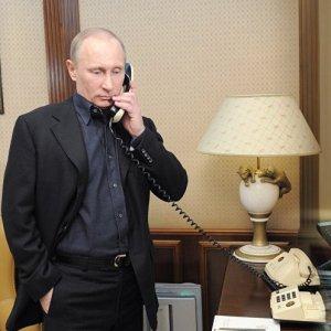 Donald Trump (R) and Vladimir Putin