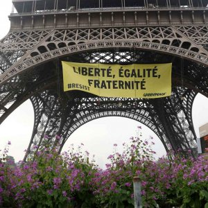 In a major security breach, Greenpeace activists partially scaled the Eiffel Tower to hang a giant anti-Le Pen banner in Paris, France, on May 5.