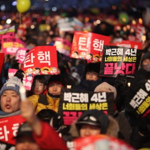 "Protesters hold signs reading ""Impeachment"" in Seoul, South Korea, on Feb. 25."