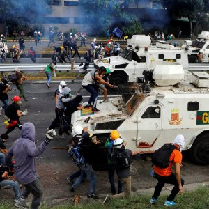 Demonstrators clash with riot police during a May Day rally against Maduro  in Caracas, Venezuela, on May 1.