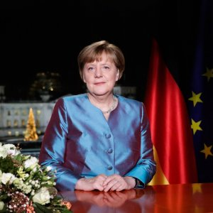 Merkel Defends Refugee Plan in New Year Message