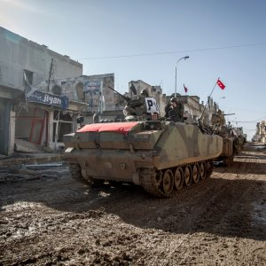 Turkish Army's armored vehicles and tanks drive in the Syrian town of Kobani on Feb. 22, 2015. (File Photo)