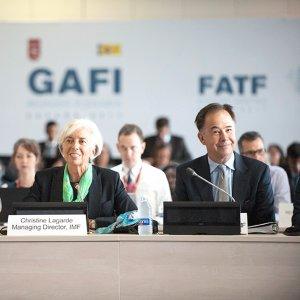FATF President Juan Manuel Vega-Serrano (L) and IMF President Christine Lagarde (C) attended the plenary meeting in Valencia, Spain.