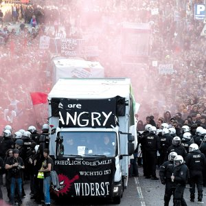 "Riot police block the ""Welcome to Hell"" rally against the G20 summit in Hamburg, northern Germany on July 7."