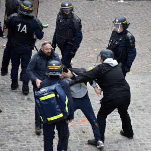 A screen shot from a video showing Alexandre Benalla wearing a police helmet and manhandling a protester in Paris in May.
