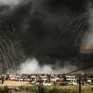 Israeli forces shoot tear gas at demonstrators  along the Gaza border on June 29.