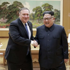 US Secretary of State Mike Pompeo (L) shakes hands with North Korean leader Kim Jong-un during  a meeting at Workers' Party of Korea headquarters in Pyongyang, North Korea on May 9.