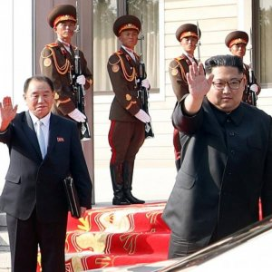 North Korean leader Kim Jong-un, standing next to former spy chief and senior official Kim Yong-chol, waves  to South Korean President Moon Jae-in after their summit at the truce village of Panmunjom, North Korea on May 26.