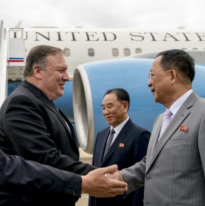 US Secretary of State Mike Pompeo (L) is greeted by North Korean Director of the United Front  Department Kim Yong-chol (C) and North Korean Foreign Minister Ri Yong-ho (R) as he arrives  at Sunan International Airport in Pyongyang on July 6.