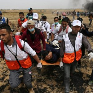 A wounded Palestinian is evacuated during clashes with Israeli troops  on the Israel-Gaza border in the southern Gaza Strip on April 27.
