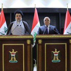 Iraqi Shia cleric Muqtada al-Sadr (L) speaks during a news conference with Iraqi Prime Minister Haider al-Abadi in Baghdad, Iraq on May 19.