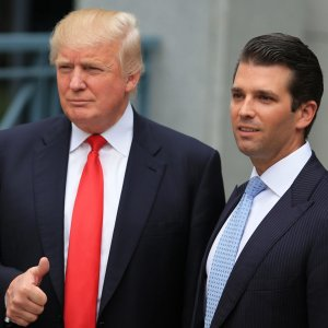 Donald Trump (L) and his son Donald Jr.