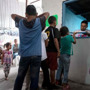 Asylum seeking children from Mexico and Central America line up for their breakfast at a migrant shelter. (File Photo)