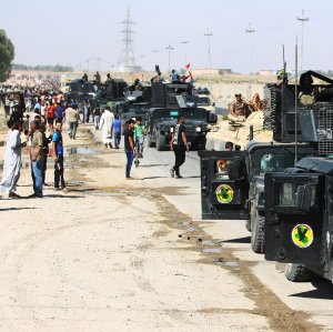 Iraqi forces arrive in the first neighbourhood on the southern outskirts of Kirkuk on October 16. (Photo: AFP)