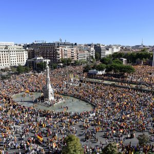 People take part in pro-union demonstrations across Spain calling for peace and dialogue between leaders on October 7.