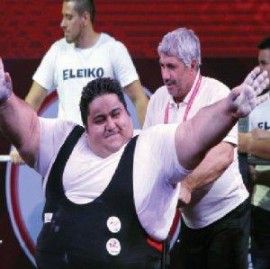 Siamand Rahman (L) and Mansour Pourmirzaei celebrate their victories in Mexico City.
